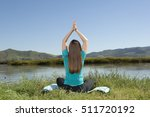 young woman is practicing yoga... | Shutterstock . vector #511720192