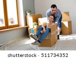 happy young couple unpacking or ... | Shutterstock . vector #511734352