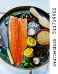 raw salmon fillet and brown... | Shutterstock . vector #511739902