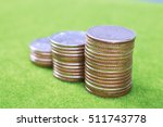 Stack Of Coins On Green...