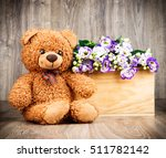 bunch of flowers and a teddy... | Shutterstock . vector #511782142