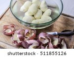 peeled potatoes in glass bowl... | Shutterstock . vector #511855126