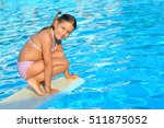 child in swimming pool ... | Shutterstock . vector #511875052