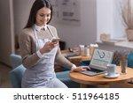 glad cute girl using cellphone... | Shutterstock . vector #511964185