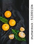 mandarins on dark fabric... | Shutterstock . vector #512001106