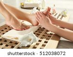foot massage in spa salon ... | Shutterstock . vector #512038072