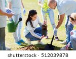 Small photo of volunteering, charity, people and ecology concept - group of happy volunteers planting tree and digging hole with shovel in park