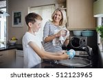 mother and son doing the dishes ... | Shutterstock . vector #512123965
