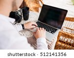 man is looking at laptop with... | Shutterstock . vector #512141356