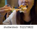 eating japanese food as close up | Shutterstock . vector #512173822