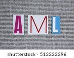 Small photo of AML (Acute Myeloid Leukemia) acronym on grey background