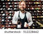 portrait of a sommelier in... | Shutterstock . vector #512228662