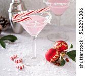 Small photo of Peppermint martini cocktail with coconut flakes rim and candy cane
