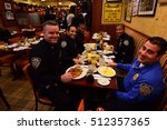 Small photo of NEW YORK CITY - NOVEMBER 4 2016: Key figures in New York's Democratic Party gathered at Junior's in Brooklyn for Steve Cohn's annual pre-election breakfast. NYPD Community Affairs Bureau.