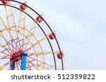 ferris wheel and blue sky  | Shutterstock . vector #512359822