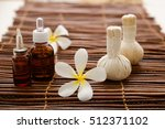 frangipani with massage oil and ... | Shutterstock . vector #512371102
