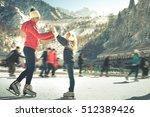 happy family outdoor ice... | Shutterstock . vector #512389426