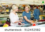 female customers standing near... | Shutterstock . vector #512452582