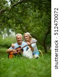 mature couple with guitar   in... | Shutterstock . vector #512470072