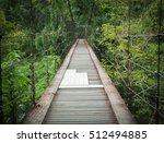 wood bridge gateway in forest | Shutterstock . vector #512494885