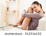 dreamful girl relaxing on sofa | Shutterstock . vector #512516152