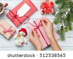 female hands wrapping christmas ... | Shutterstock . vector #512538565