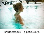 woman enjoying hydrotherapy and ... | Shutterstock . vector #512568376