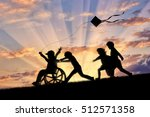 happy boy in wheelchair playing ... | Shutterstock . vector #512571358