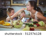 kids feeding a slice of yellow... | Shutterstock . vector #512576128