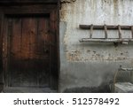 Small photo of An artless door and wall of farmers house, Bhutan.