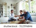 financial advisor shaking hands ... | Shutterstock . vector #512596846
