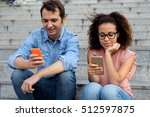 two friends using their mobile... | Shutterstock . vector #512597875
