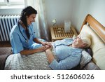 nurse interacting with senior... | Shutterstock . vector #512606026