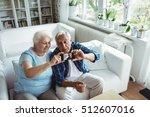 senior couple taking a photo... | Shutterstock . vector #512607016