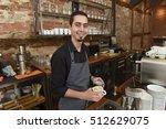 young italian barista or coffee ... | Shutterstock . vector #512629075