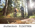 biker couple riding mountain... | Shutterstock . vector #512657806