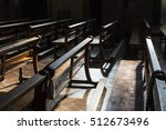 Row Of Wooden Benches Inside A...