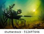 underwater shot of the hunter... | Shutterstock . vector #512697646