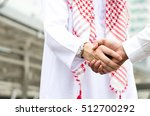 arab businessman shake hand... | Shutterstock . vector #512700292