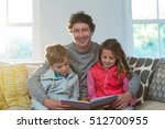family reading a book at home | Shutterstock . vector #512700955