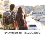 back view of a couple of... | Shutterstock . vector #512702092