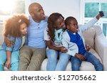 family taking selfie from... | Shutterstock . vector #512705662