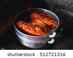 maine lobster is cooking in the ... | Shutterstock . vector #512721316