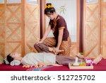 thai masseuse doing massage for ... | Shutterstock . vector #512725702