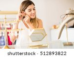 beautiful young woman trying on ... | Shutterstock . vector #512893822