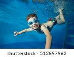 Little Boy Swims Underwater In...