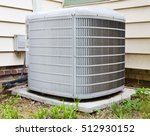 Small photo of Air conditioning compressor in backyard