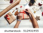 girl decorates a christmas gift ...   Shutterstock . vector #512931955
