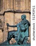 a bronze statue of the roman...