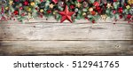Stock photo christmas header border of fir branches and baubles on old wood 512941765